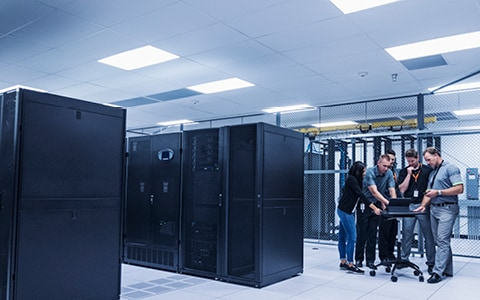 Server room with technology professionals